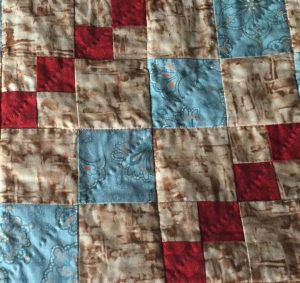 hand quilting on this lap quilt